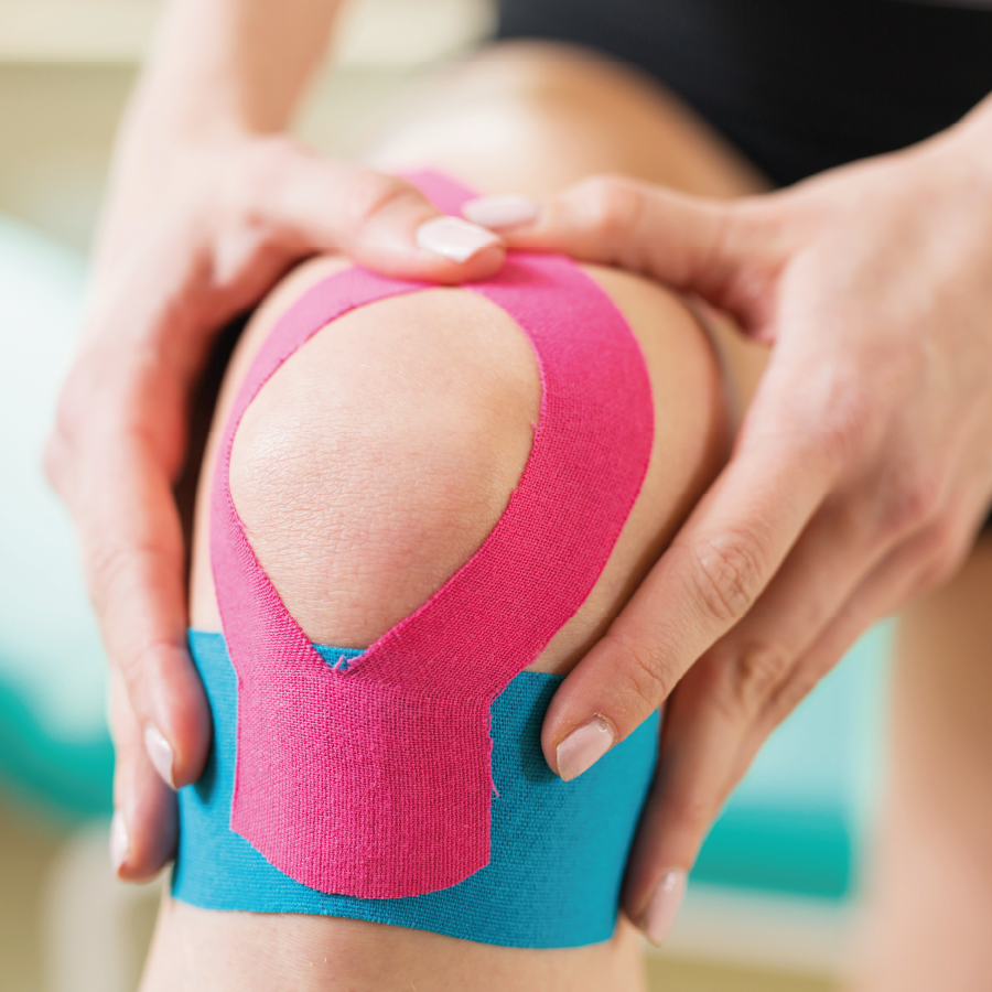 woman's knee with kinesiotaping to represent Specialist Sports Rehabilitation by Pringle Physiotherapy